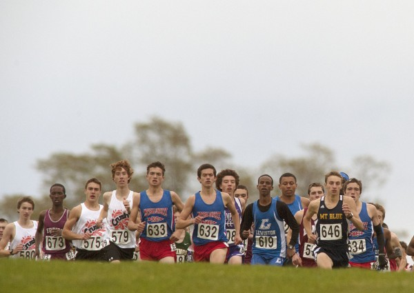 Runners begin the Eastern Maine Class A cross country championship race in Belfast, Maine Saturday, Oct. 26, 2013.