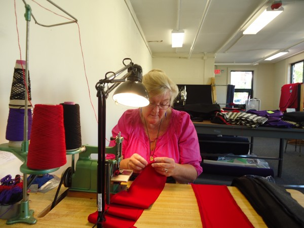 Dory Waxman, a former Portland City Councilor, makes shawls at her new Old Port Wool and Textile Co. on Danforth Street, which opens next weekend.