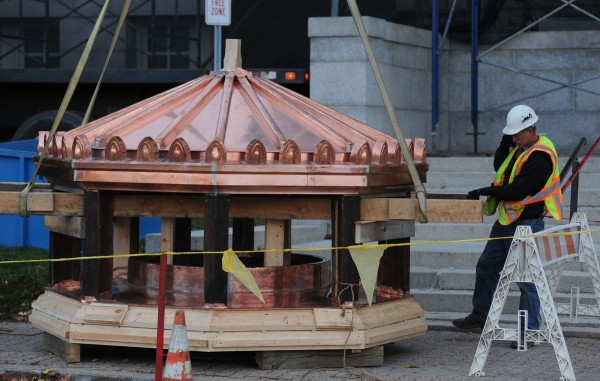 The copper top to the Bangor Public Library dome is inspected before it is lifted into place early Friday morning.