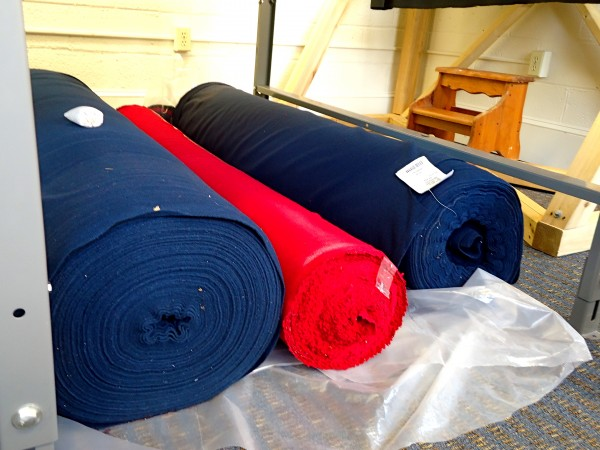 Rolls of wool cloth manufactured in Oxford Maine await the sewing machines at Old Port Wool and Textile Co.
