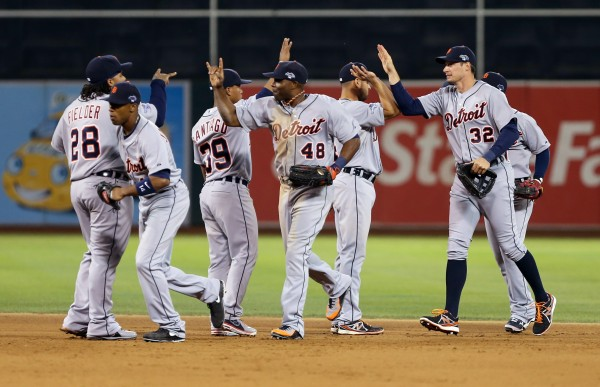 Members of the Detroit Tigers celebrate after their win against the Oakland Athletics in game one of an American League divisional series playoff baseball game at O.co Coliseum in Oakland Friday night.