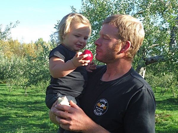 Liberty Davis shows her father Jason a ripe apple in the family orchard. Jason resurrected his family farm after 26 years of dormancy.