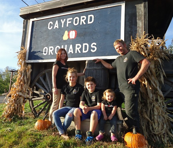 The Davis family poses for a portrait outside their orchard. From left, Heather, Cortlynn, Ben Davis, Liberty, all named after apples and Jason Davis.