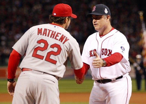 St. Louis Cardinals manager Mike Matheny (22) and Boston Red Sox manager John Farrell (53) shake hands before game one of the World Series at Fenway Park on Wednesday night.