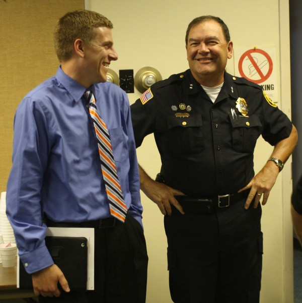 Caribou City Manager Austin Bleess (left) shares a laugh with Police Chief Michael Gahagan during a surprise party thrown for Gahagan in late August to commemorate his 40 years of service with the Caribou Police Department.
