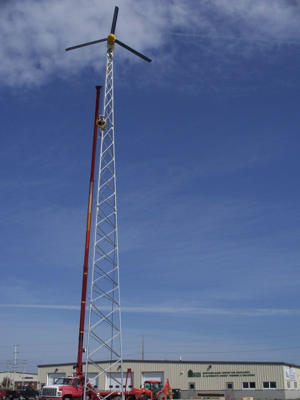 Crews from Northern Electric Inc. of Ashland install an 80-foot-tall residential wind turbine at the site of Northern Maine Community College's Northern Maine Center for Excellence in Alternative Energy Training and Education on Skyway Street in Presque Isle in August 2011.