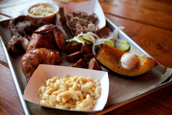 A tray of food is served up at Salvage BBQ in Portland, including chicken, ribs, pork, squash and coleslaw.