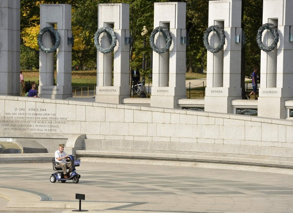 U.S. Army veteran John Esposito, 98, of Scarsdale, New York, who was wounded at the Battle of the Bulge, rides a scooter as he tours the World War Two Memorial, in Washington, October 5, 2013, as the government shutdown continues into the weekend. Technically closed due to the shutdown, the Park Service Rangers have allowed anyone to visit inside the gates, especially &quotHonor Flight&quot veterans.