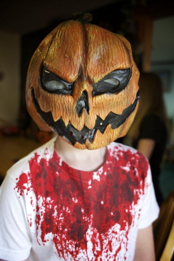 Nathaniel Cusack, 12, shows off his infamous pumpkin mask that he says he's used to scare many people. Amy Violette and her two children are really into Halloween.