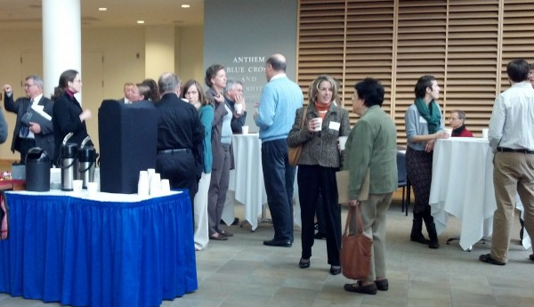 People gather before the MaineFocus: Solutions for Maine's Economy event at University of Southern Maine. The seminar brings together business, government, and civil-sector leaders to tackle issues such as career development, long-term economic outlook, and best HR practices for Maine.