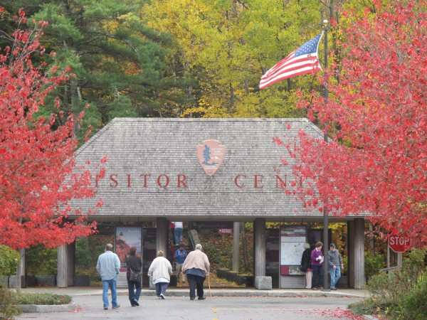 Visitors at Acadia National Park walk toward the main entrance of the park's visitors center in Bar Harbor on Thursday, Oct. 17, after the park had been closed for 16 days due to the federal shutdown.