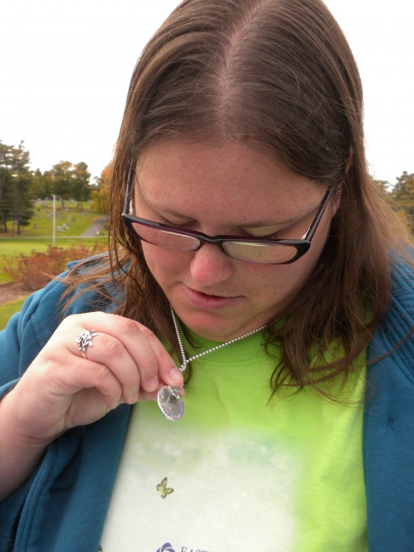 Orrington resident Michelle Paradis looks at a remembrance necklace she wears for her daughter, Anastasia, who died in childbirth in March. She and her husband, Toby, participated in the Empty Arms Remembrance Walk on Saturday, Oct. 5, 2013, through Mount Hope Cemetery in Bangor. She said the Empty Arms support group has helped the couple to grieve and to know they are not alone.