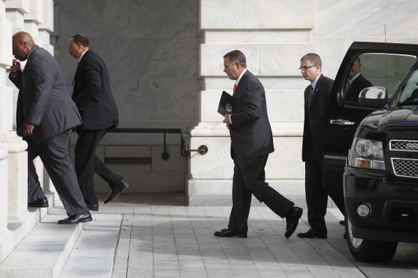 U.S. House Speaker John Boehner, R-Ohio, (center) arrives at the U.S. Capitol in Washington, October 16, 2013.