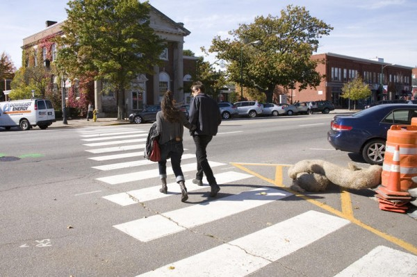 People cross Maine Street in Brunswick where one of the town's raised crosswalks will be installed by the end of October 2013.