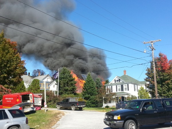 A Pleasant Street garage caught fire Sunday afternoon in Blue Hill, sending flames at least 50 feet into the sky above the structure.