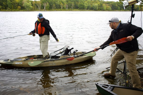 Marketing Manager for Johnson Outdoors Lucas LaBree (right) straightens out the Old Town Predator MX Kayak during a photo shoot for the kayak in Veazie Tuesday afternoon.