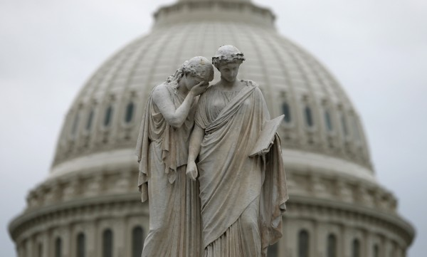 The statue of Grief and History stands in front of the U.S. Capitol Dome in Washington October 16, 2013.