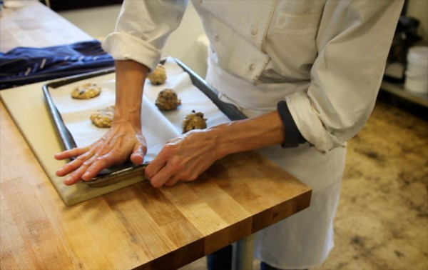 Pamela Fitzpatrick Plunkett of Little Bigs bakery in South Portland makes a batch of apple, raisin, pecan and oatmeal cookies. The treats were once named one of Oprah's favorite things.