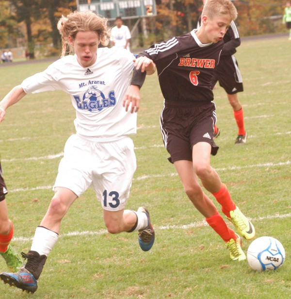 Brewer High School's Carter Smith (6) hooks up with Mt. Ararat's Ty Veno (13) during KVAC boys soccer action Saturday in Topsham.