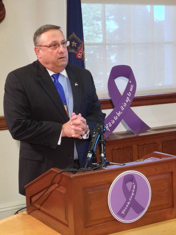Gov. Paul LePage addresses advocates, his staff and the press during a ceremony marking October as Domestic Violence Awareness Month.