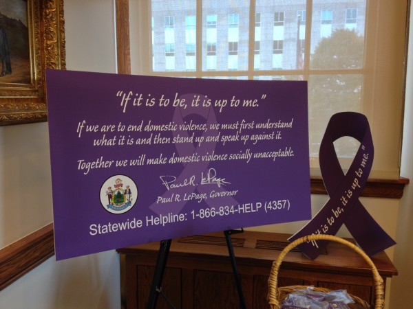 This sign stood as a backdrop to Gov. Paul LePage's short speech and proclamation establishing October as Domestic Violence Awareness Month.