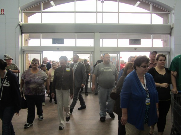 Customers enter the new Wal-Mart supercenter in Thomaston moments after the doors opened Wednesday morning.