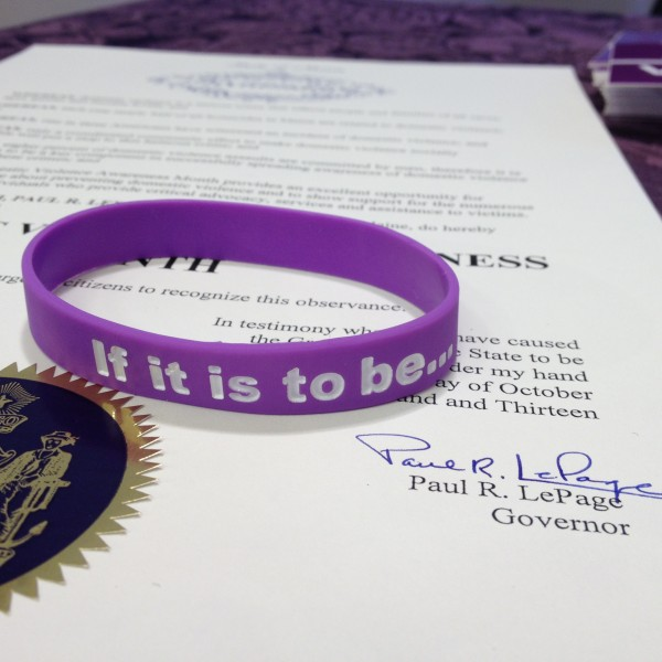 To mark October as Domestic Violence Awareness Month, Gov. Paul LePage handed out purple bracelets inscribed with the words, &quotIf it is to be, it is up to me.&quot The phrase, which was used often in his first gubernatorial campaign, is meant to signify that every Mainer has a role to play in fighting domestic violence.