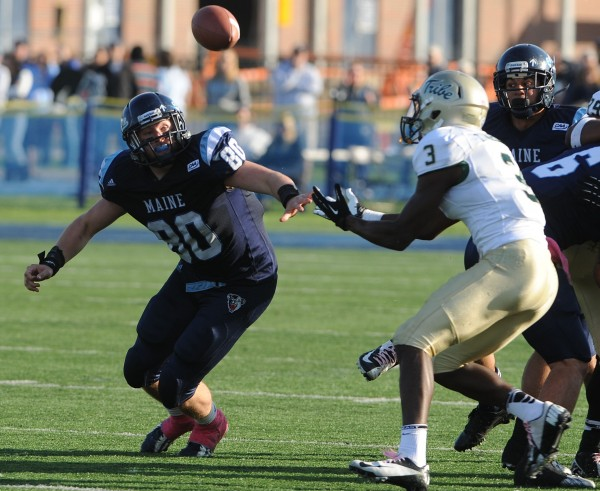 UMaine's Justin Perillo (left) eyes a tipped ball after an on-sides kick by William and Mary during second-half action Saturday in Orono. William and Mary's Tre McBride pulled in the tipped ball.