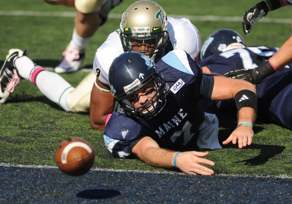 UMaine quarterback Marcus Wasilewski watches the ball roll into the end zone after losing it earlier in the play. UMaine recovered it for a touchdown during first-half action at Orono on Saturday.