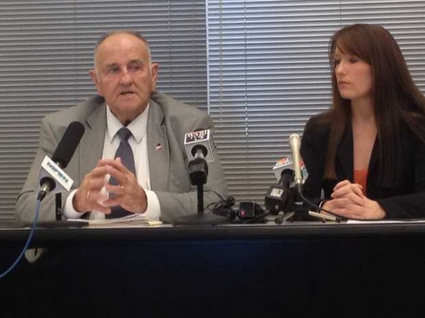 Maine Finance Commissioner Sawin Millett, left and Adrienne Bennett, right, director of communications for Gov. Paul LePage, brief statehouse reporters and other media in this December 2012 file photo.