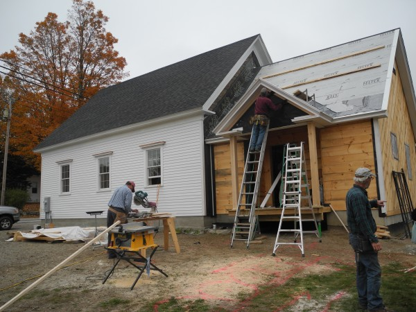 Volunteers work Thursday on constructing the addition to the one-room schoolhouse that will become the Lincolnville Community Library. By August, 75 volunteers had donated 2,500 hours of volunteer time toward the project, according to organizers.