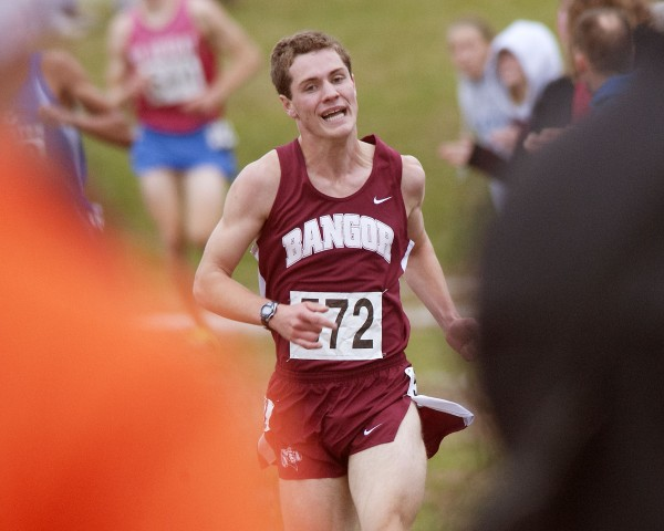 Bangor runner Jonathan Stanhope puts on a burst in the final stretch of the Boys Class A EM cross country race in Belfast on Saturday, Oct. 26, 2013.