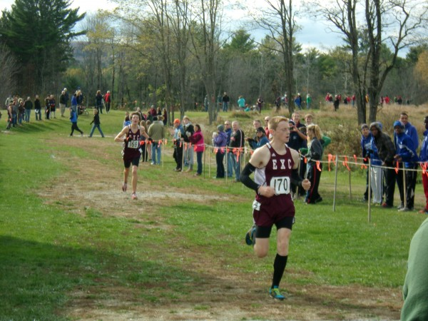 Ellsworth's Dan Curts cruises across the finish line to claim the Class B individual title at the Eastern Maine Cross Country regional championships Saturday in Belfast. Curts' Eagles went on to win the team crown.