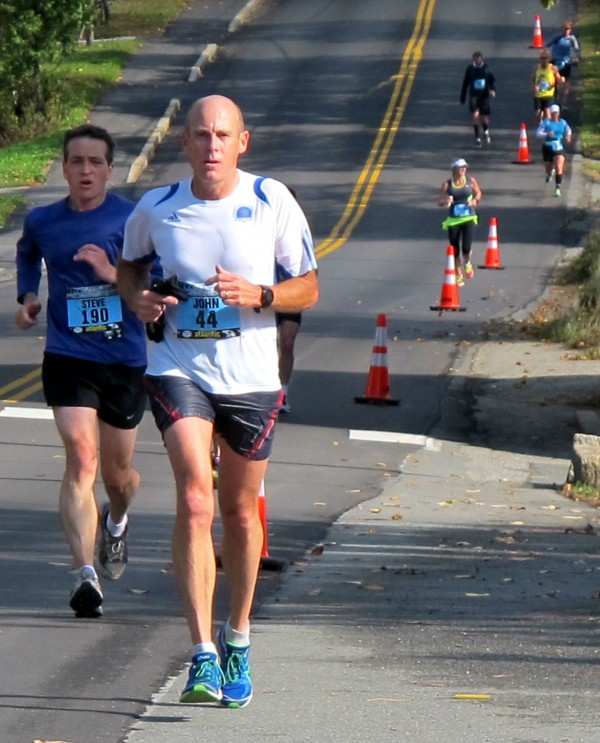 John Lovell of Brentwood, Tenn., leads Steve Colt of Anchorage, Alaska and other runners along Route 102 in the Mount Desert Island village of Somesville during the MDI Marathon on Sunday, Oct. 20.