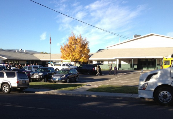 Investigators are at the scene of shooting at Sparks Middle School in Sparks, Nevada October 21, 2013. Four people, including students, were hurt after a shooter opened fire at a middle school in the northern Nevada city of Sparks on Monday, a county official said.