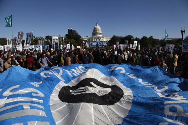 Demonstrators hold a parachute as they protest during the &quotStop Watching Us: A Rally Against Mass Surveillance&quot near the U.S. Capitol in Washington, October 26, 2013.