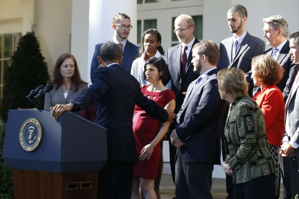 U.S. President Barack Obama reaches out to help Affordable Care Act beneficiary Jessica Ugalde, who began to faint during the president's speech about healthcare from the Rose Garden of the White House in Washington October 21, 2013.