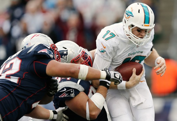 New England Patriots defensive tackle Chris Jones (94) sacks Miami Dolphins quarterback Ryan Tannehill (17) during the fourth quarter of their 27-17 win at Gillette Stadium in Foxborough, Mass., Sunday.