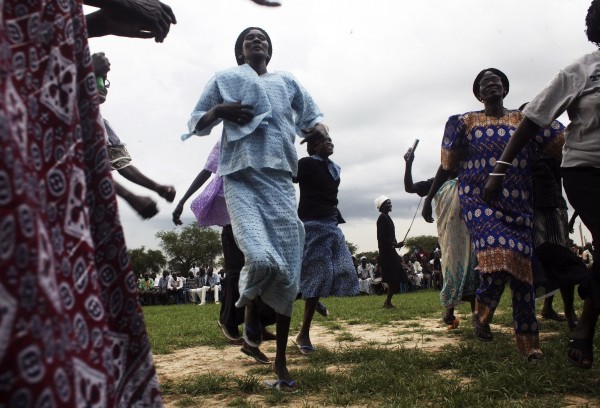 Women from the Ngok Dinka tribe dance during prayers for a peaceful referendum in the Abyei region, September 14, 2013. Abyei, straddling the border between Sudan and South Sudan, is claimed by both sides, which fought one of Africa's longest civil wars. Since South Sudan's secession in 2011 after an independence vote, both countries have been unable to decide on the ownership of Abyei, which is inhabited by the Dinka tribe allied to South Sudan and the Misseriya, an Arab tribe following Sudan.