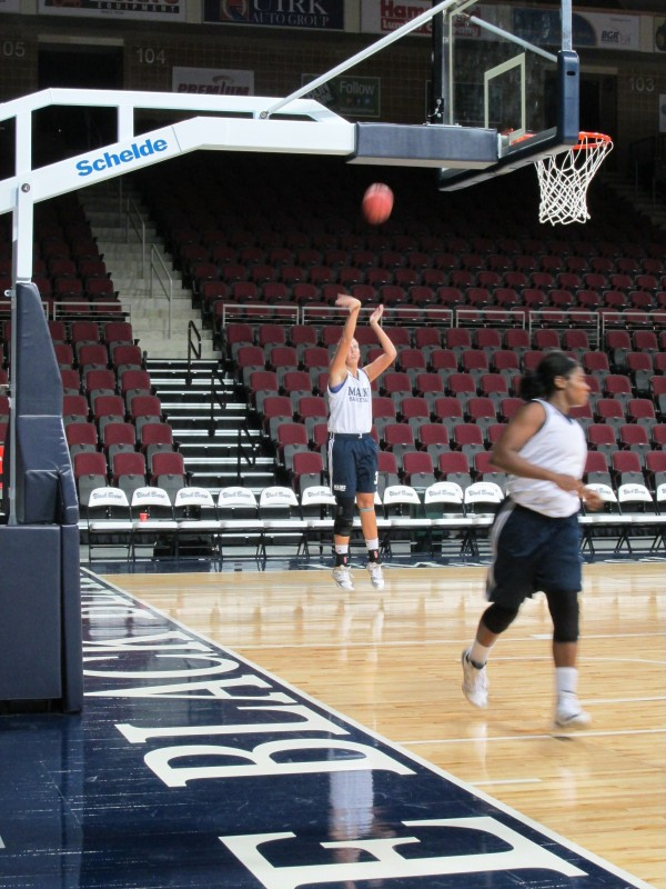 Ali Nalivaika (background) practices her shooting touch during an Oct. 22 practice in Bangor.