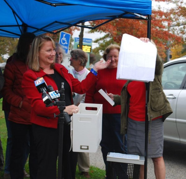 Katy Foley, who took out the petition to repeal Scarborough's new leash law, announces Wednesday, Oct. 16, that signatures from more than 2,800 residents were collected.