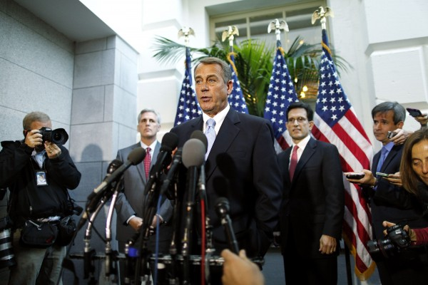 U.S. House Speaker John Boehner (R-OH) (C) is flanked by House Majority Whip Rep. Kevin McCarthy (R-CA) (L) and Majority Leader Rep. Eric Cantor as he speaks to reporters at the U.S. Capitol in Washington, October 15, 2013. House Republicans hope to pass their own legislation to reopen the federal government, rejecting the deal that emerged from Senate negotiations.