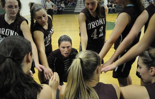 Orono High School head coach Jessica Witham, (kneeling in center) huddles with her Red Riots players during a game in 2011. Witham is among six people who will be inducted into the Orono High School Athletic Hall of Fame Friday night.