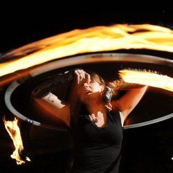 Kimberly Hursh spins fire at West Market Square in Bangor on Thursday. Hursh is a fire spinner with  Flames of Hope a project to raise money for charity.