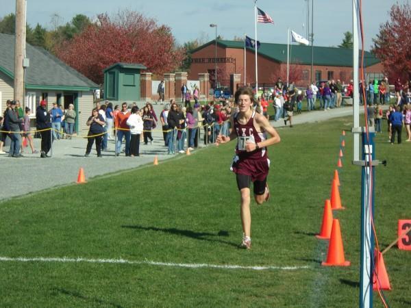 Ellsworth senior Brayden Beardsley crosses the finish line to win the individual title at the Penobscot Valley Conference cross country championship meet at Hermon High School on Saturday. Beardsley completed the race in 16 minutes, 51.12 seconds and his Eagles claimed the large school team title.