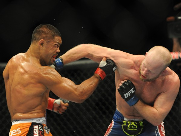 Lincolnville native Tim Boetsch (right) battles Mark Munoz during their middleweight UFC bout at the MGM Grand Garden Arena in this July 2013 file photo.