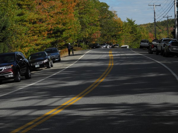 Cars were parked alongside Eagle Lake Road near an access point for Acadia National Park's carriage trails on Saturday afternoon. Park rangers remaining on duty during the partial government shutdown said that they were overwhelmed by visitors ignoring the barricades to bike, hike and otherwise enjoy the park.