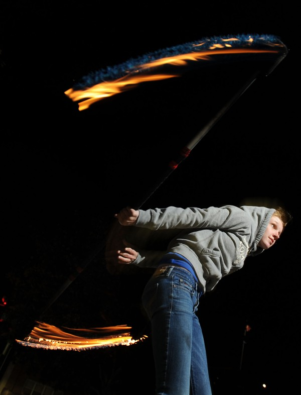 Christina Price spins fire at West Market Square in Bangor on Thursday. Price is a fire spinner with  Flames of Hope a project to raise money for charity.