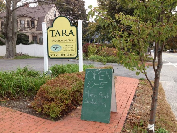 A sandwich board stands outside Tara Home & Gift on Shore Road in Cape Elizabeth, where a proposal to loosen restrictions on the signs is headed to the Town Council.
