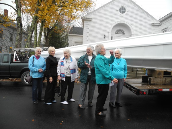 On Friday morning, the six &quotsteeple people&quot - ladies aged 72 to 91 years old - watched as the steeple was raised to the roof of the Stockton Springs Community Church.